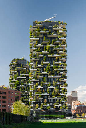 """MILAN, ITALY - SEPTEMBER 19 2015: """"Bosco Verticale"""" (""""Vertical Forest"""") is a pair of two residential towers in the district of Porta Nuova, Milan; they host hundreds of trees and plants in the balconies"""