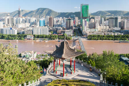Panoramic view of Lanzhou (China) with a traditional temple in the foreground
