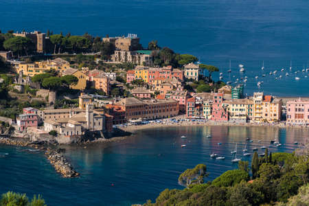 The seafront and the beach of Sestri Levante, seen from distant surrounding hills