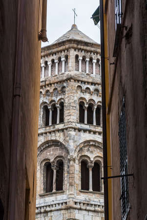 Glimpse of the bell tower of San Donato church in the downtown of Genoa