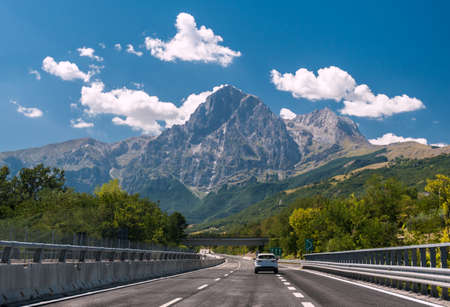 An highway in Italy. The mountain Gran Sasso in background