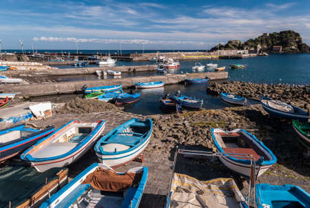 Small port in Aci Trezza (Sicily, Italy); the island Lachea in the background Imagens