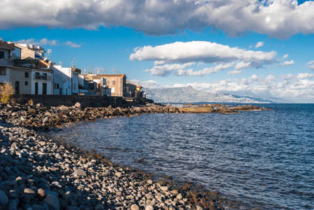 The small sea village of Torre Archirafi (Catania, Sicily) with its typical rocky beach Imagens