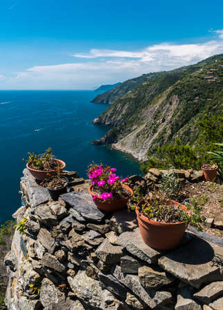 The coastline of Liguria, in the Cinque Terre area; in the foreground the staircase leading to the isolated village of Monesteroli Imagens