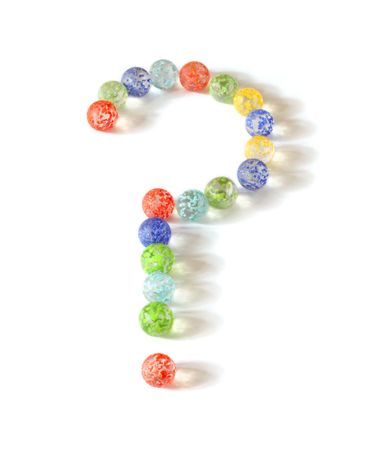 showpiece: Glass marbles make question mark Stock Photo