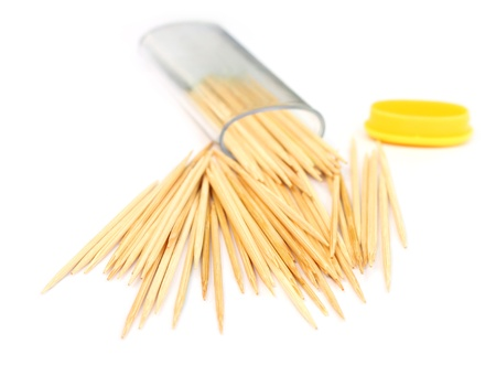 Golden tooth-picks over white background Stock Photo - 8358097