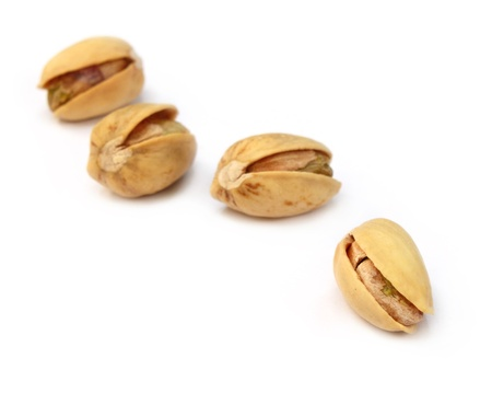 Pistachios isolated over white background Stock Photo - 9735774