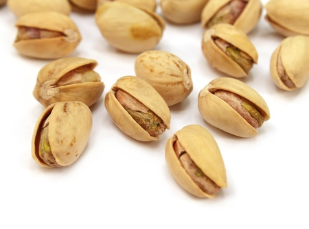 Pistachios with selective focus over white background Stock Photo - 9735778