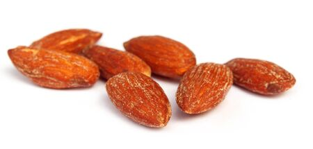 Almonds with selective focus over white background Stock Photo - 9735777