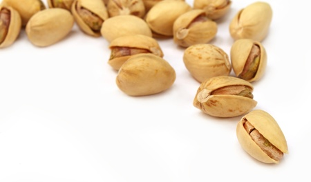 Pistachios over white background Stock Photo - 9947596