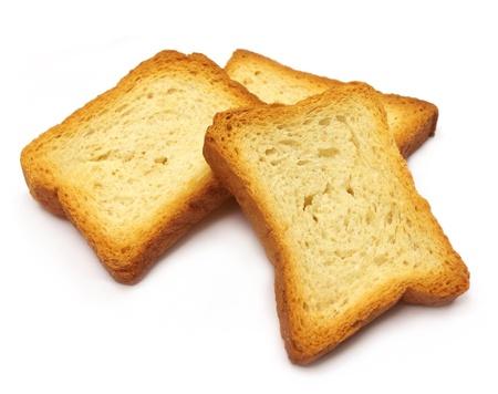 melba: Galletas tostadas sobre fondo blanco