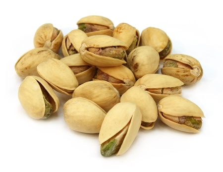 Pistachios over white background Stock Photo - 10527085