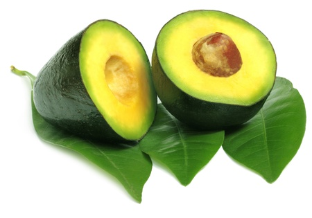 Fresh tropical avacado fruit with green leaves Stock Photo