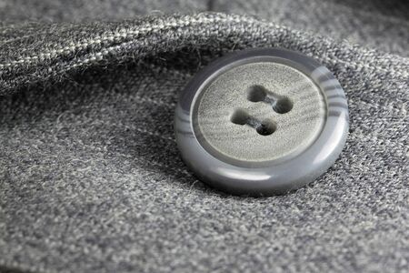 blue grey coat: Button on a gray suit