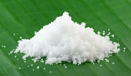 Sea salt on banana leaf photo