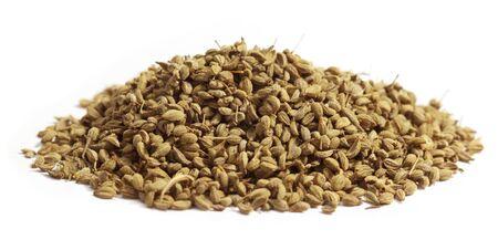 Herbal ajwain seeds over white background