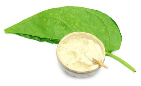 betelnut: Betel leaf with a vintage pot of lime