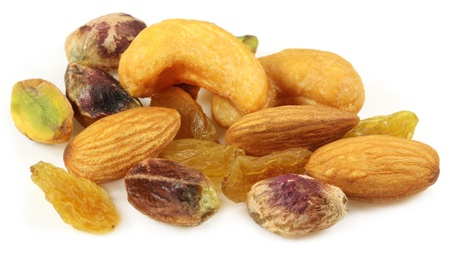 Mixed nuts with raisin over white background photo
