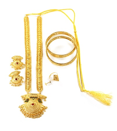 Wedding gold jewelry for Indian bride over white background photo