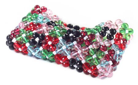 Colorful handbag made of plastic beads over white background photo