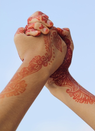 Arm wrestling with henna tinted hand photo