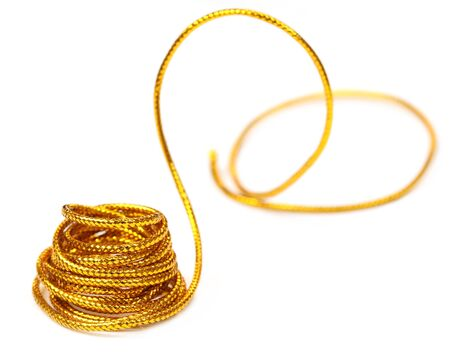 Golden rope over white background photo