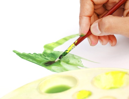 Artist painting with brush