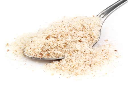 dysentery: Medicinal Isabgol or psyllium husks with a spoon Stock Photo
