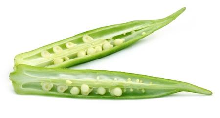 Sliced okra on white background photo
