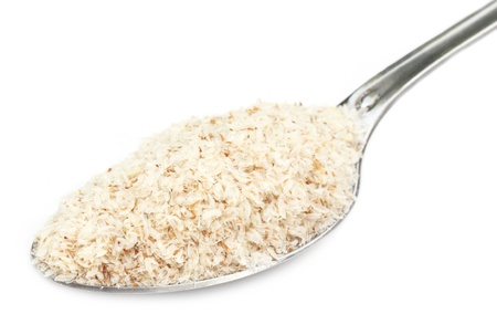 albumin: Medicinal Isabgol or psyllium husks on a spoon