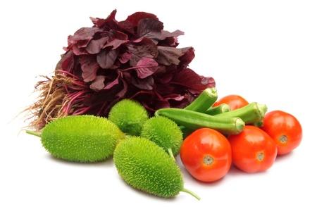 long bean: Fresh vegetables – Cucumber, tomato and okras, amaranth, kakrol Stock Photo