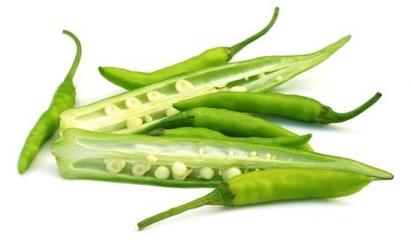 Sliced okras wit chillies photo