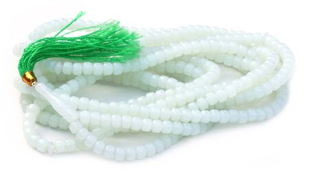 almighty: Rosary over white background