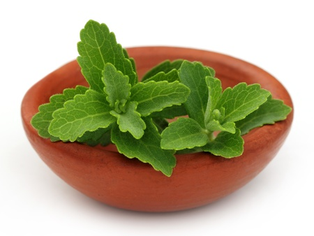 steviol: Stevia on a brown bowl over white background Stock Photo