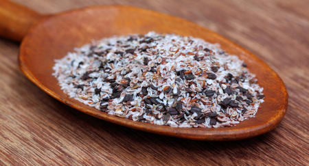 albumin: Medicinal herbs on a wooden spoon