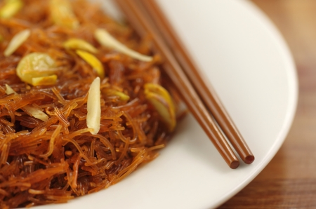 Sweet vermicelli with chopstick photo