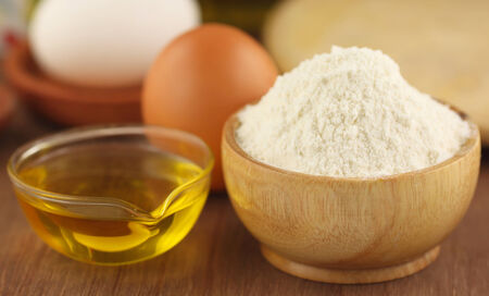 cooking oil: Flour with eggs and cooking oil Stock Photo