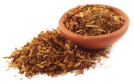 Tobacco for making cigarette on a small bowl over white background