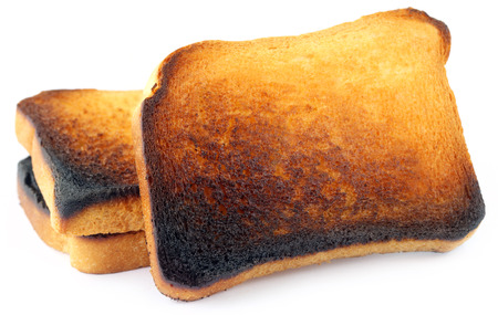 burnt toast: Burnt Toast over white background Stock Photo