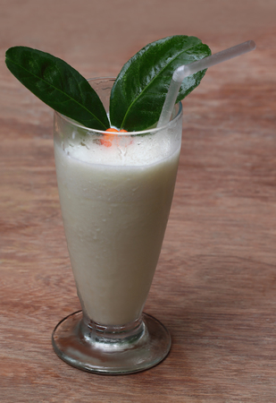 subcontinent: Fresh Lassi of Indian subcontinent on wooden surface