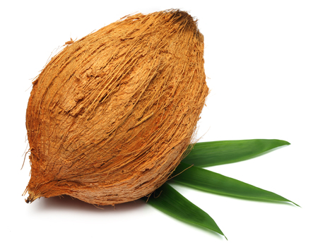 Fresh coconut with leaves over white