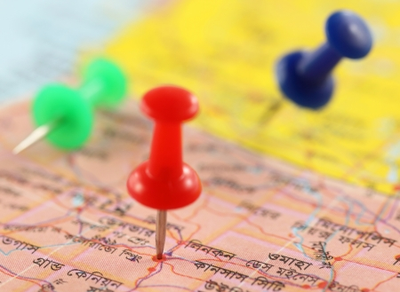 Close up of Pushpins pointing place on a paper map photo