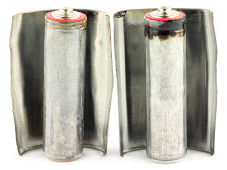 Old Alkaline Batteries over white background photo