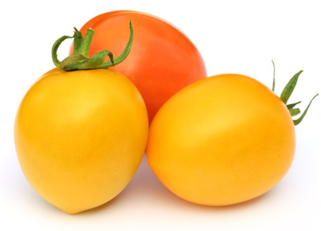 Ripe tomatoes of two colors over white background Stock Photo - 25063611