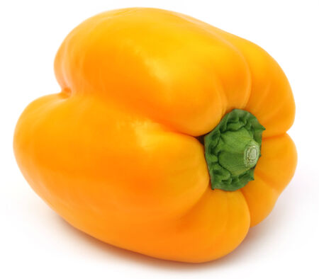 Yellow capsicum over white background photo
