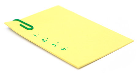 Notepad with paper clip over white  photo