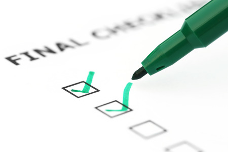 Final Check list with green pen over white paper Stock Photo