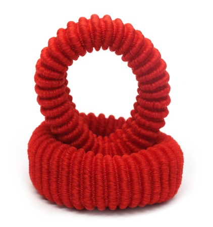 elastic garments: Two red hair elastics over white background