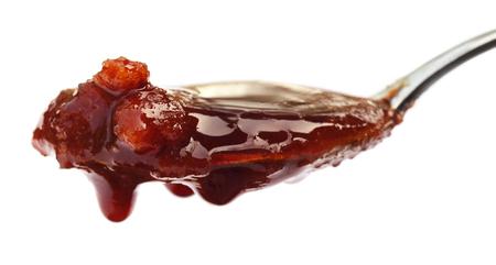 Date Molasses over white background Stock Photo