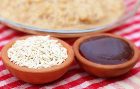 Date molasses with Payesh made of handmade vermicelli photo